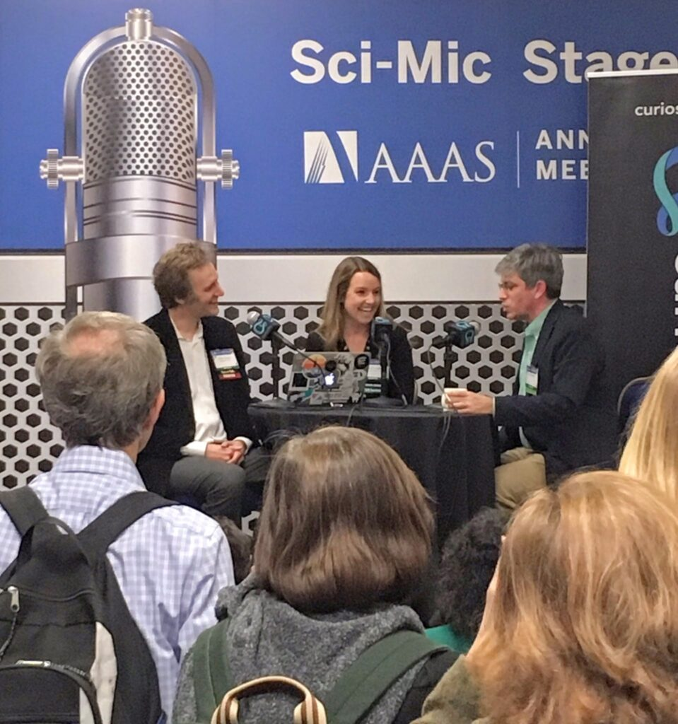 From left to right: hosts Cody Gough and Ashley Hamer interview Carl Zimmer, award-winning columnist for The New York Times and author of several books about science, on the Sci-Mic Stage at the AAAS Annual Meeting in Washington, D.C.
